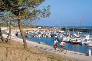 Mmmm... Palmyre! Even though it's busy in the summer, there's always a slow pace of life to La Palmyre, best appreciated on two wheels, like these cyclists passing by Palmyre's marina.