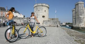 "They Call me Yellow Vélo... Some ladies pose with the free ""Yélo"" bikes."