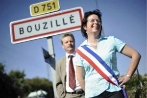 No cock-up here! Bouzillé's mayor puts the sunny side out in front of one of France's funniest signs