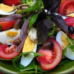 Lettuce, tomatoes, egg, Nice olives, tomato, tuna, anchovies, peppers... Salade Niçoise.