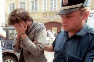 Lithuanian police lead Bertrand Cantat away after the death of his fiancée Marie Trintignant