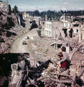Capital of Ruins: Two young residents of St-Lô watch American troops depart for the front in 1944
