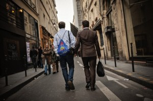 Main-en-main: a couple of Marais residents strolling its historical streets