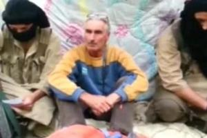 French hostage Hervé Gourdel in a video screen grab taken with his kidnappers on Monday