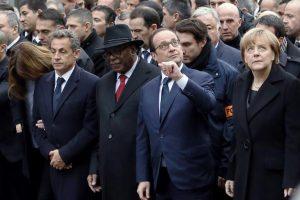 Global photo-bombing: Nicolas Sarkozy manages to get to the front of the queue, next to Mali president Boubacar Keita