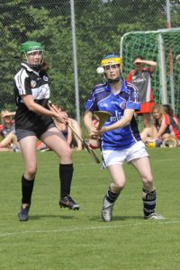 A camogie player of the Paris Gaels in the blue strip