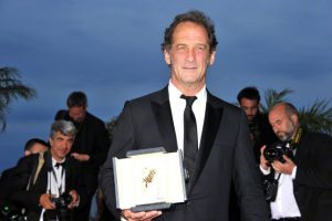 Actor Vincent Lindon, winner of the Best Actor Prize for his role in the film ' La Loi du Marché' poses at the photocall for the winners of the Palm D'Or during the 68th annual Cannes Film Festival on May 24, 2015 in Cannes --- Image by © Lavinia Fontana/Geisler-Fotopres/dpa/Corbis